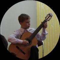 Гитарист Павел Кухарчик