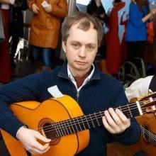 Гитарист Сергей Рощектаев