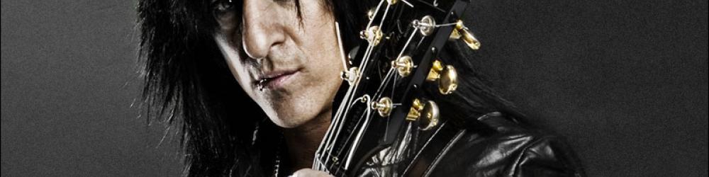 Гитарист Стив Стивенс